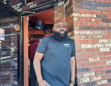 Faheem Alexander, owner of Faheem's Hands of Precision Barber Shop, said he and his staff try and set good examples for young people. But to fight gun violence it's going to take others to pitch in. (Ximena Conde / WHYY)
