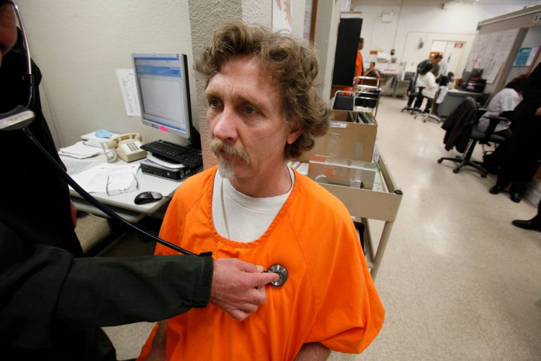 Prison inmate is examined by a doctor