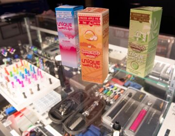 This Jan. 2, 2020, file photo shows flavored vaping liquids and devices on display at the VapeNY.com store in New York. (AP Photo/Mary Altaffer)