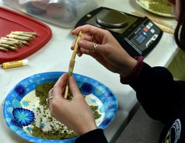 Maesa Story, a worker at Montana Advanced Caregivers, packs a joint with marijuana at the Billings, Mont. medical marijuana dispensary on Nov. 11, 2020. Recreational marijuana initiatives passed in four states this year, from liberal New Jersey to conservative Montana and South Dakota. The results prove how broadly accepted marijuana has become throughout the country and across party lines. (AP Photo/Matthew Brown)