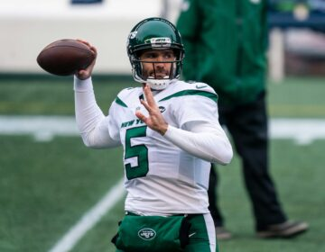 Then-New York Jets quarterback Joe Flacco passes the ball during warmups before an NFL football game against the Seattle Seahawks, Sunday, Dec. 13, 2020, in Seattle. (AP Photo/Stephen Brashear)
