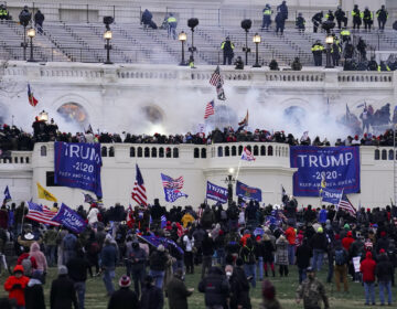 In this Wednesday, Jan. 6, 2021, file photo, rioters storm the Capitol, in Washington. (AP Photo/John Minchillo)