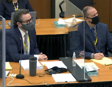 In this image taken from video, defense attorney Eric Nelson, left, and defendant, former Minneapolis police officer Derek Chauvin, right, listen to Hennepin County Judge Peter Cahill during pretrial motions, prior to continuing jury selection in the trial of Chauvin, Thursday, March 11, 2021, at the Hennepin County Courthouse in Minneapolis, Minn. (Court TV/Pool via Pool)