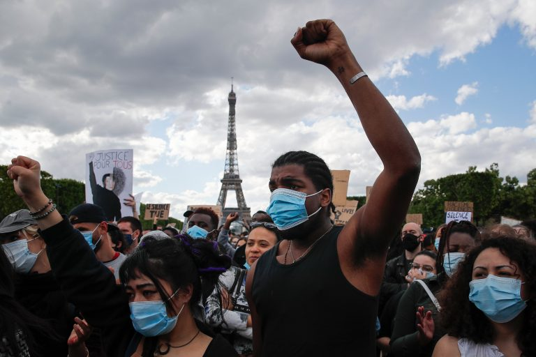 In this June 6, 2020, file photo, hundreds of demonstrators gather on the Champs de Mars as the Eiffel Tower is seen in the background during a demonstration in Paris to protest against the recent killing of George Floyd. (AP Photo/Francois Mori)