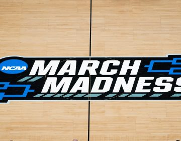The March Madness logo is shown on the court