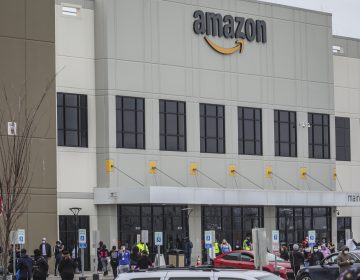 Workers at Amazon's fulfillment center in Staten Island, N.Y., gather outside to protest work condition
