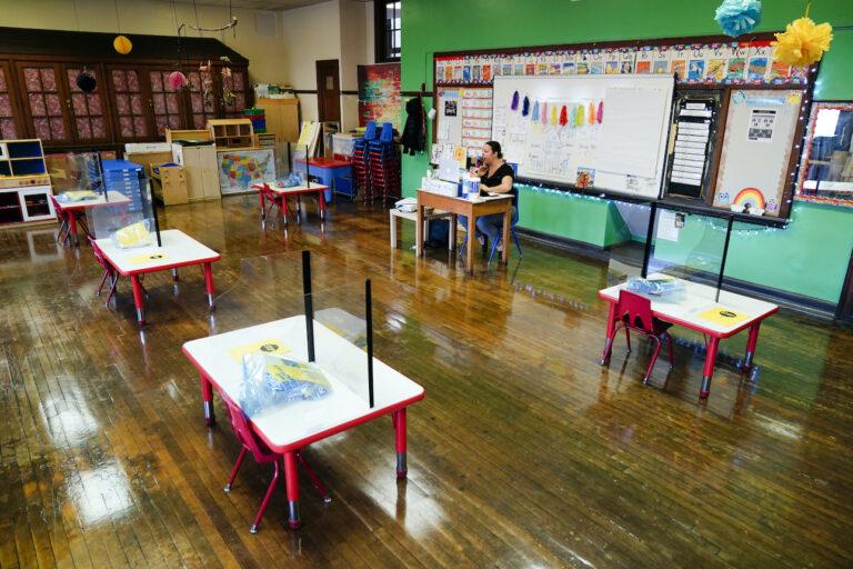 Tara Matise teaches her prekindergarten students virtually in her classroom