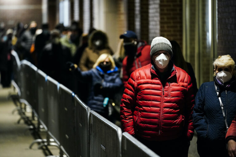 People wait in line at a FEMA Community Vaccination Center at the Pennsylvania Convention Center