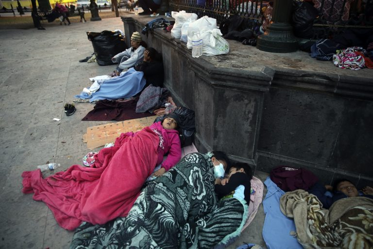 Migrants sleep under a gazebo at a park in the Mexican border city of Reynosa