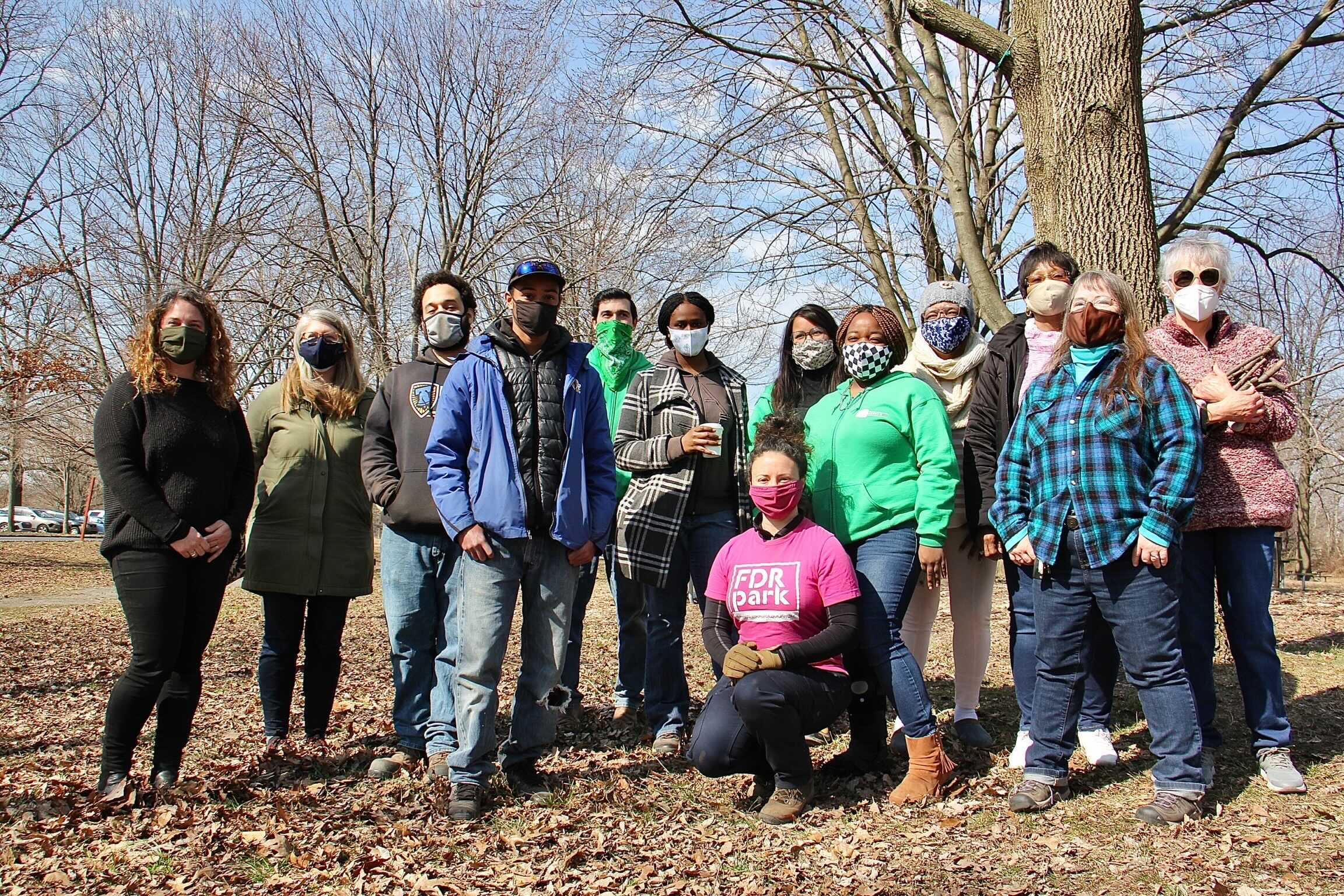 Volunteers stand in a line at FDR Park