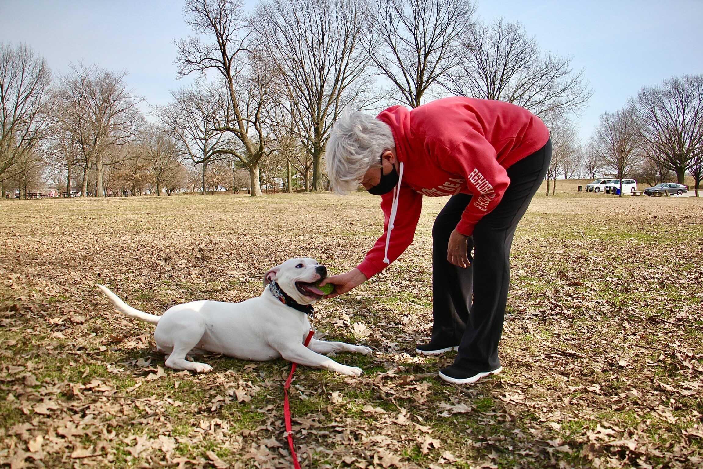 Michelle Davidson plays with her dog, Luna, at FDR Park