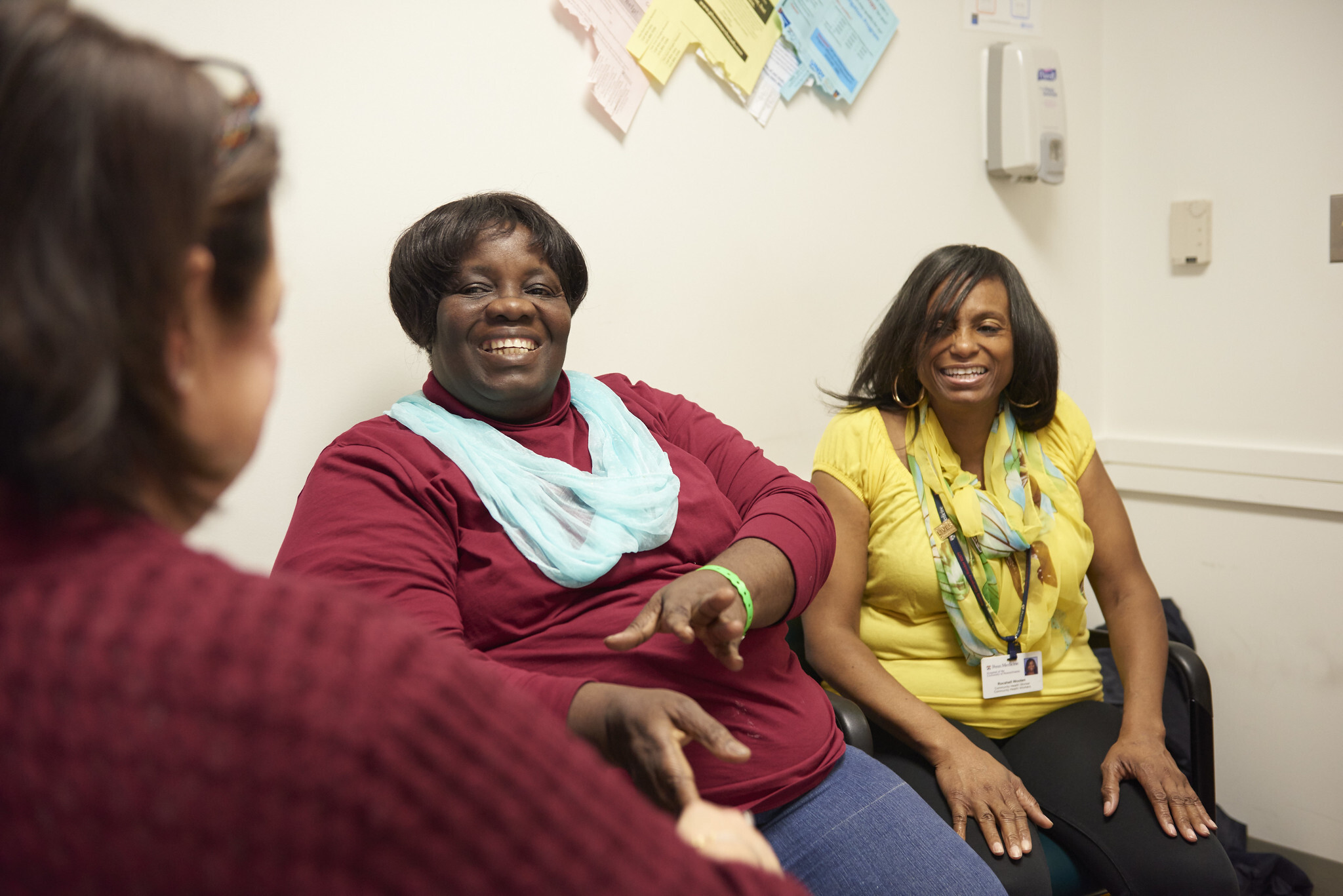 Philadelphia community health worker Rocshell Wooten (far-right) accompanies patient Grace Ikpe to their primary care appointment