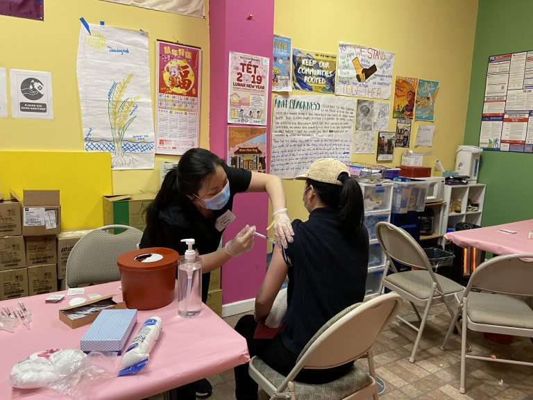 A pharmacist giving a community member the Pfizer vaccine on March 21 in South Philadelphia during Juntos and VietLead's organized vaccination event. (Courtesy of Thy Vu)