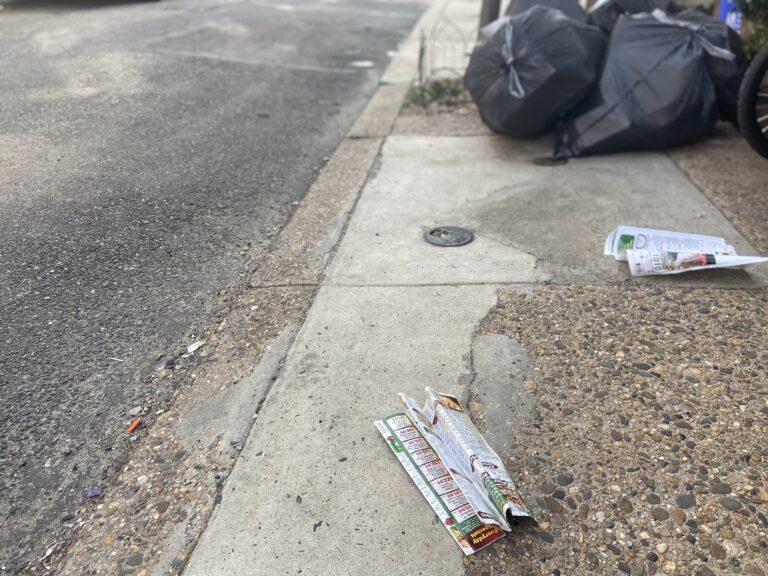 Pizza menus litter a South Philadelphia block. (WHYY)