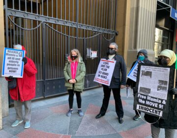 Mumia supporters advocate for him to be released from prison. (Aaron Moselle / WHYY)