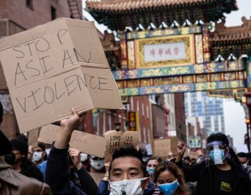 Philadelphians gathered on 10th street in Chinatown for a solidarity rally and march against violence directed at Asian Americans on March 25, 2021. (Kimberly Paynter/WHYY)