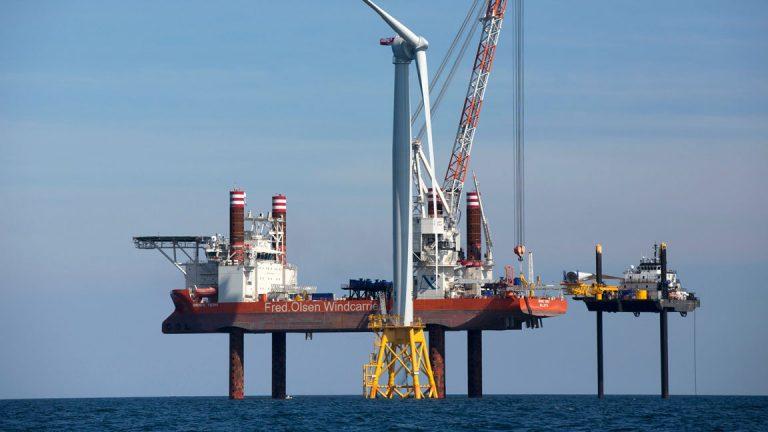 Aug. 15, 2016, a wind turbine, front, being assembled off Block Island, Rhode Island. (Michael Dwyer/AP Photo)
