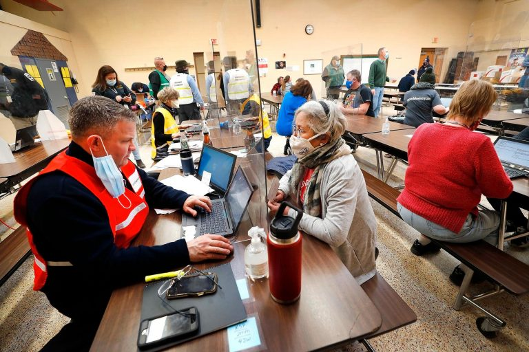 Residents move through a Pa. vaccine clinic