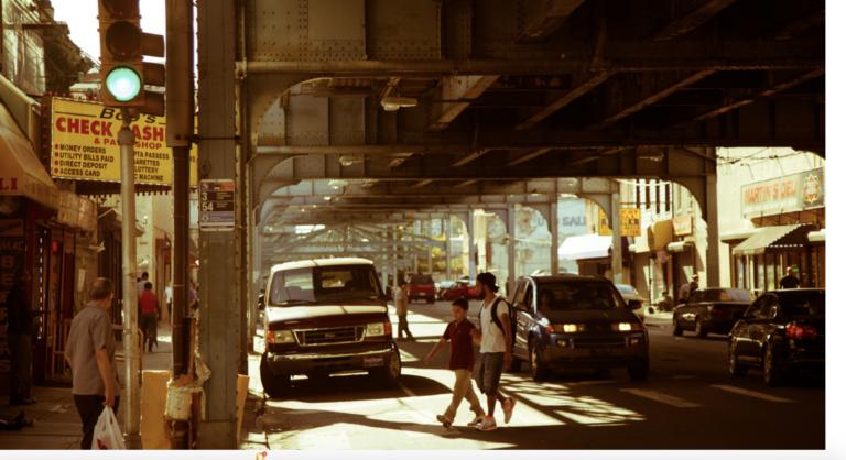 People cross Kensington Avenue to reach the Somerset Station. (New Kensington Community Development Corporation)