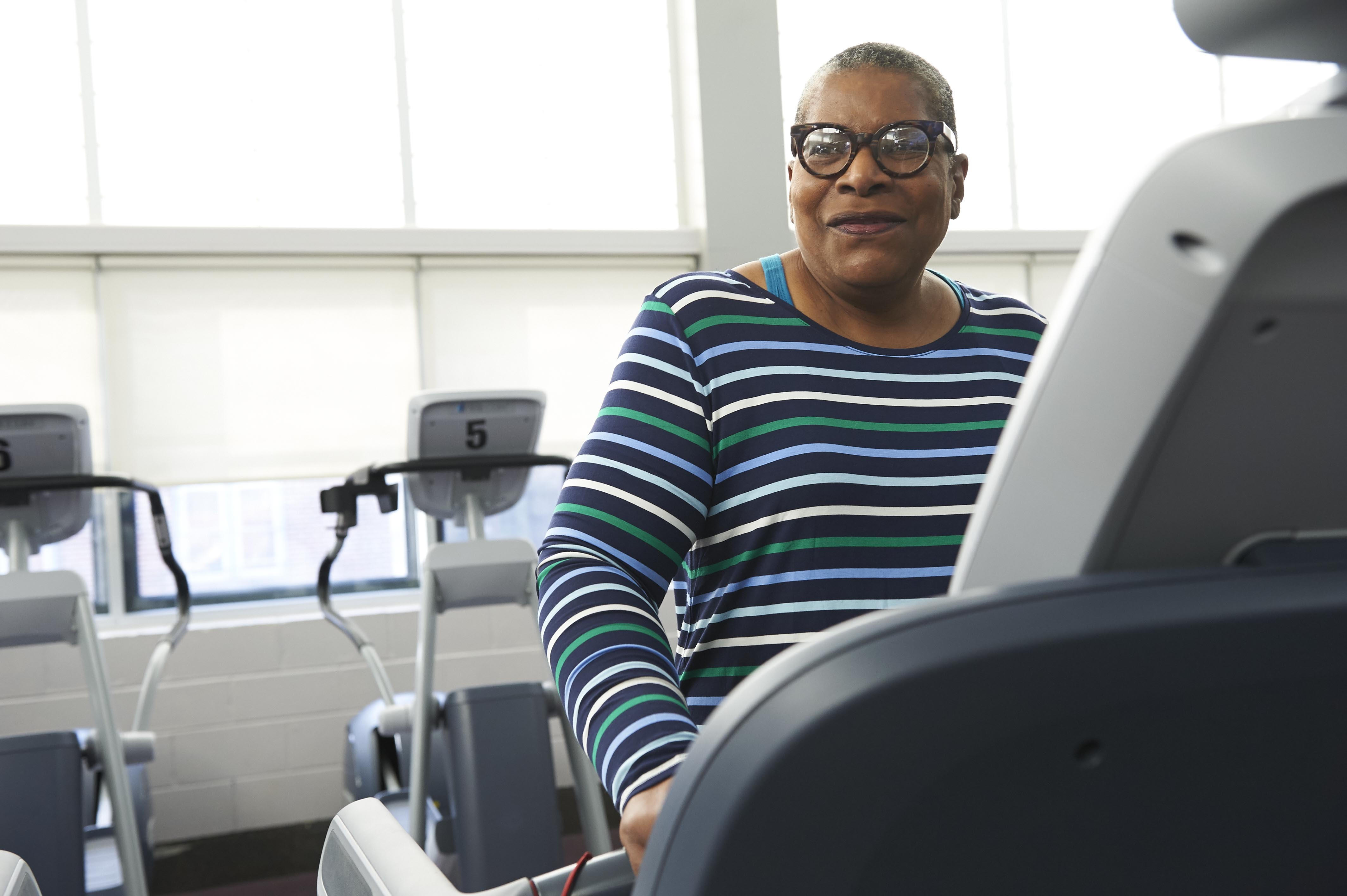 Phyllis Carter exercises on a treadmill