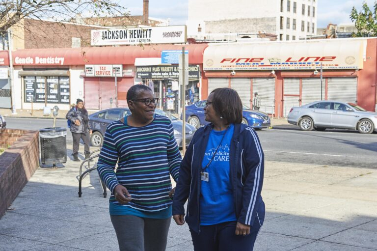 West Philadelphia resident Phyllis Carter (left) takes a walk with her community health worker