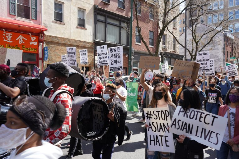 Hundreds march to Chinatown for a rally against anti-Asian hate in Philadelphia on March 27, 2021. (Kenny Cooper/WHYY)