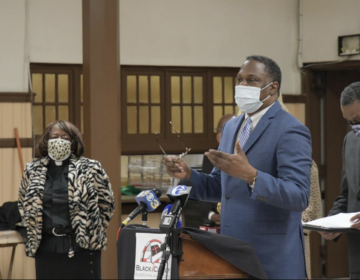 Rev. Gregory Holston discusses the Black Clergy of Philadelphia's plan to help eliminate gun violence during a news conference at Janes Memorial United Methodist Church in Germantown. (Abdul R. Sulayman/Philadelphia Tribune)