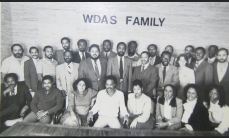Tony Brown sits in the front row fourth from the left with Dyana Williams to his immediate left. Cody Anderson stands immediately behind Brown. Jerry Wells sits third from the right.