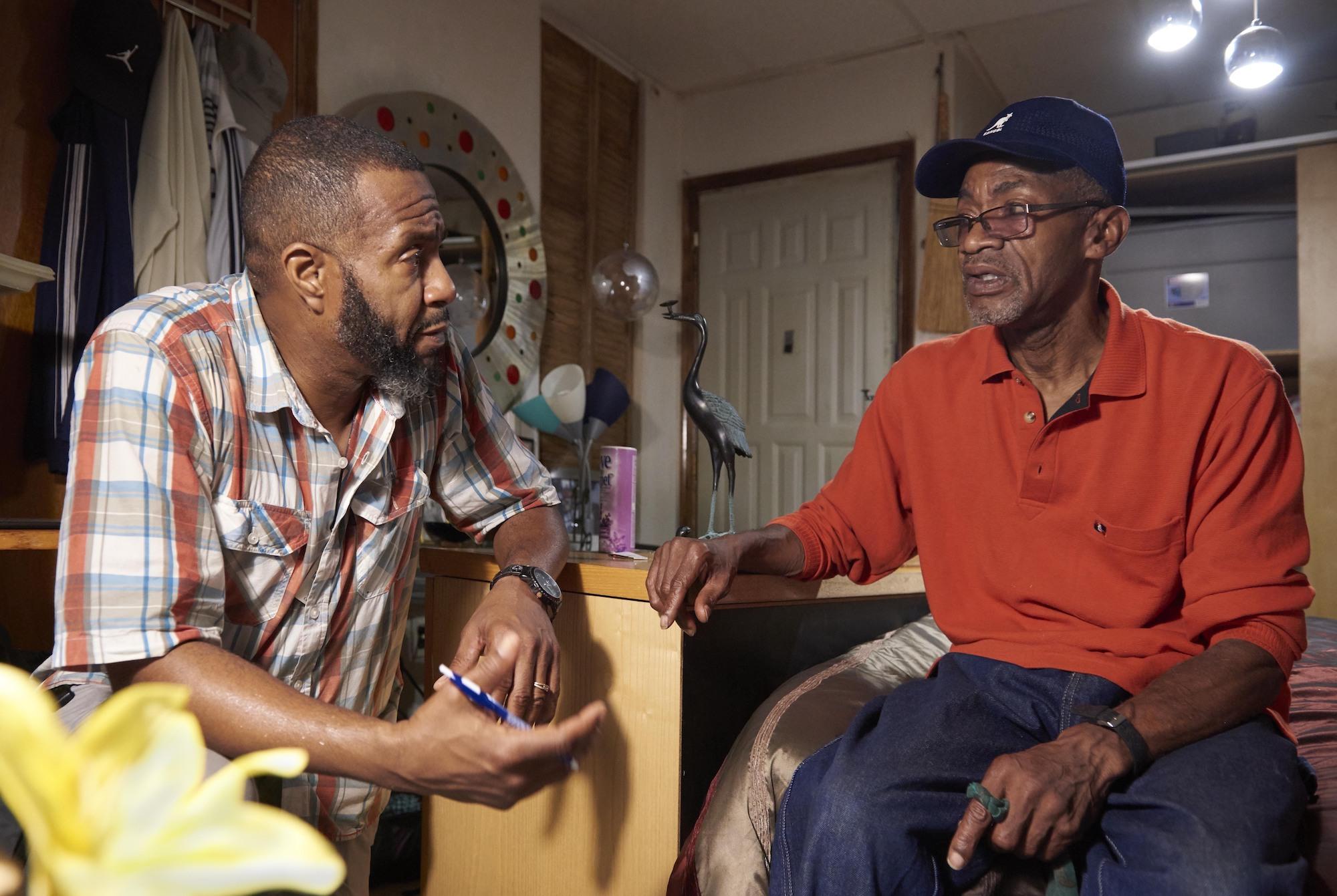 Orson Brown (left) listens to patient Walter Briggs