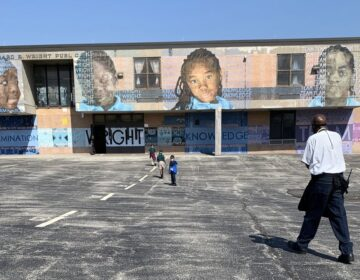 Climate specialist Charles Brown gets students back to class after recess at Richard Wright Elementary School in North Philadelphia. (Dale Mezzacappa/Chalkbeat Philadelphia)
