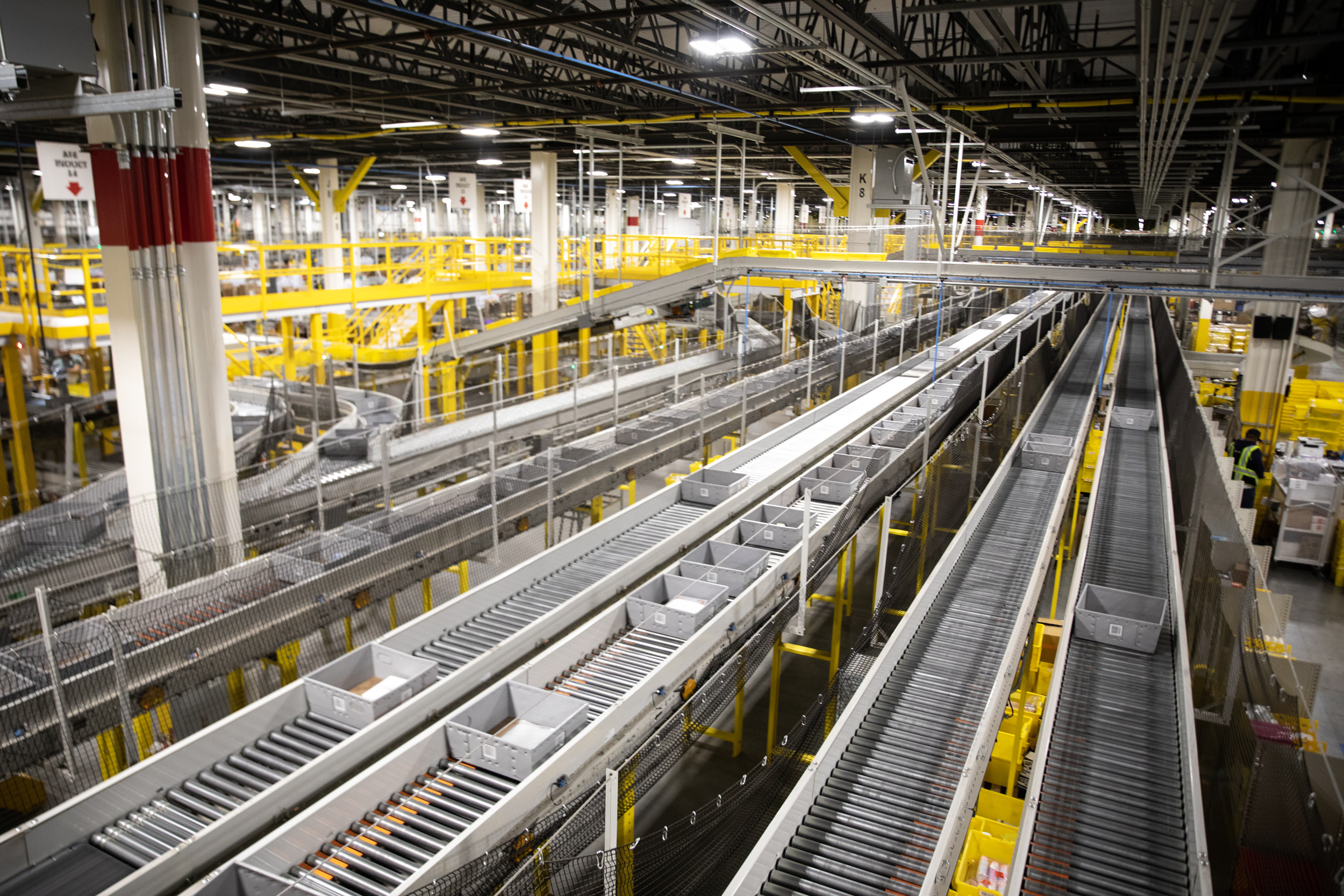Conveyor belts are pictured an Amazon fulfillment center