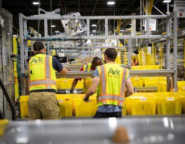 Employees work inside an Amazon fulfillment center