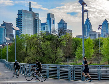 People run and bike along the Schuylkill River
