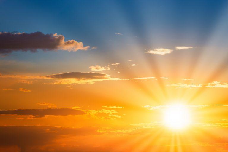 Sun rays on sunset sky