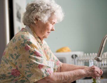 Older adult washing hands