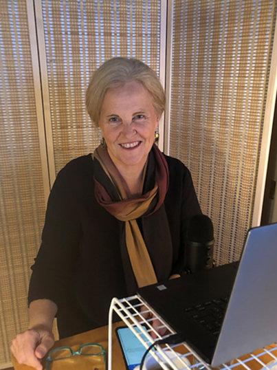 Diane Benscoter sits at a computer