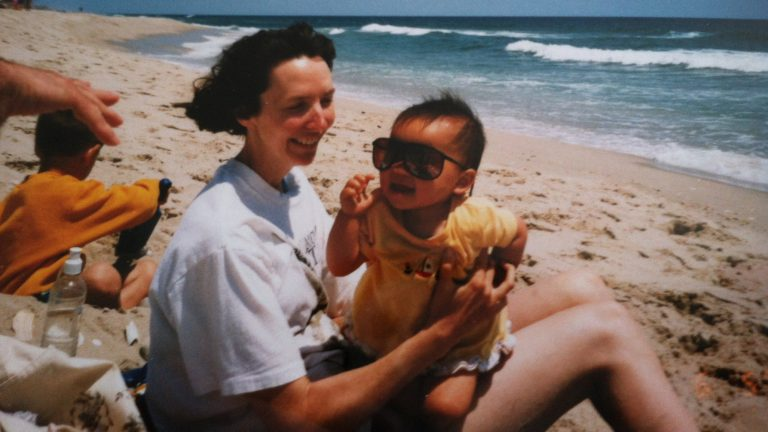 Emma LeMay, now 22, with her mother at the Jersey shore. LeMay, adopted from Chongqing China, was raised in Vermont and now lives in Atlanta. (Emma LeMay)