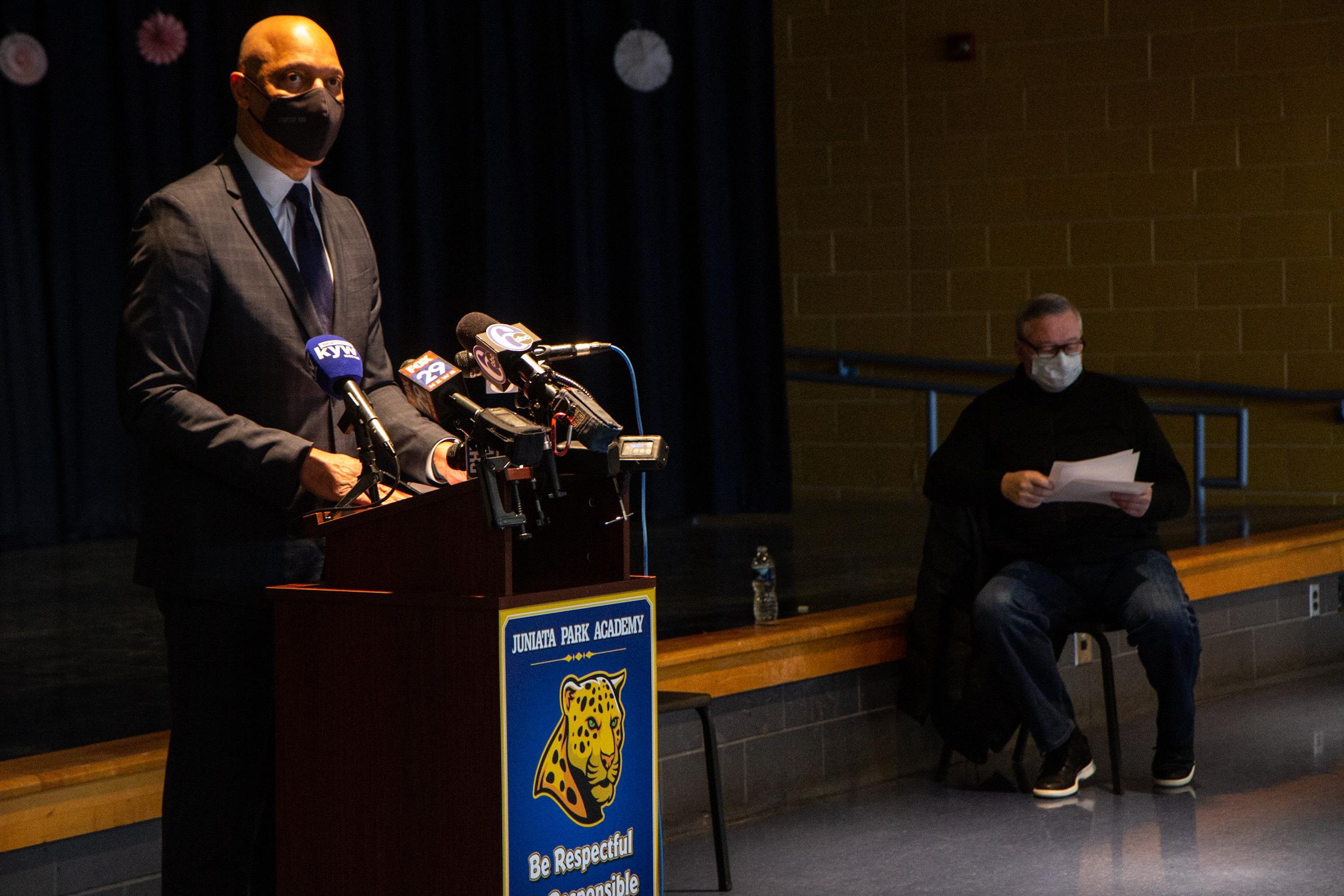 William Hite speaks from a podium