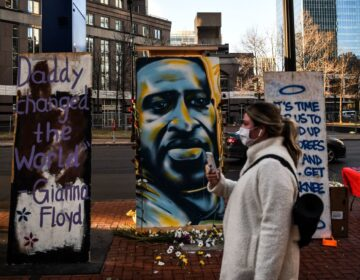 A painting of Floyd is seen outside the Hennepin County Government Center