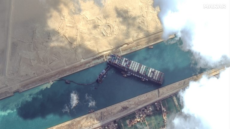 High-resolution satellite imagery shows the Suez Canal and the container ship Ever Given that remains stuck north of the city of Suez, Egypt. ScapeWare3d/DigitalGlobe/Getty Images