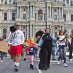 Philadelphians demanding more resources to combat gun violence in the city, marched down South Broad Street on March 26, 2021. (Kimberly Paynter/WHYY)