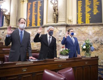 Democrats Rep. Mark Longietti (left) and Chris Sainato (center) raise their right hands