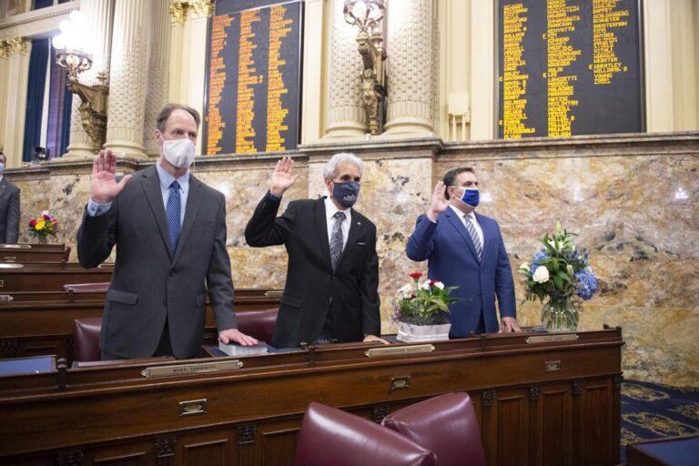 Democrats Rep. Mark Longietti (left) and Chris Sainato (center) raise their right hands