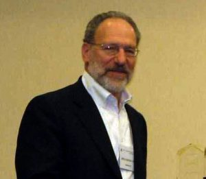Psychologist Jeffrey Sternlieb stands against a wall
