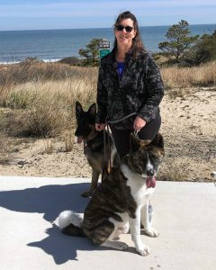 Psychologist Laura Epstein at Cape Henlopen Beach park with her two dogs