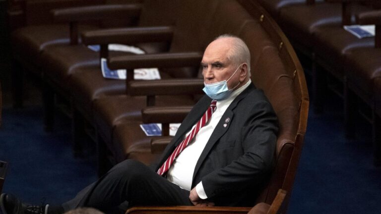 Rep. Mike Kelly, R-Pa., looks on in the House Chamber after they reconvened for arguments over the objection of certifying Arizona's Electoral College votes in November's election, at the Capitol in Washington, Wednesday, Jan. 6, 2021