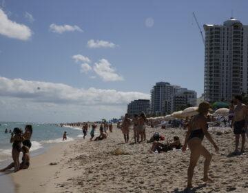 People flock to Miami Beach