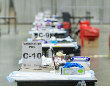 Tables are set up inside the FEMA-run coronavirus vaccination site at the Pennsylvania Convention Center in Philadelphia