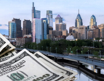 Piles of money are illustrated alongside Philly's skyline
