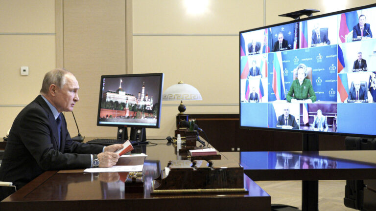 Russian President Vladimir Putin looks on at a Zoom meeting